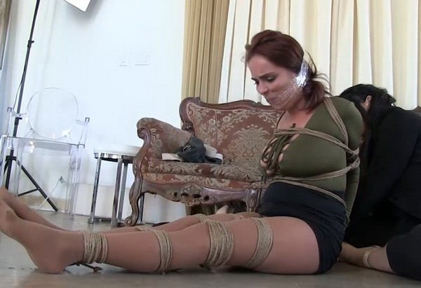 image Petite redhead tied to a chair and punished