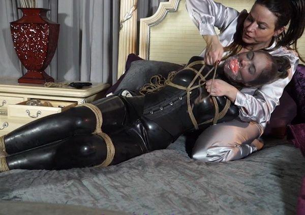 Raven tightly gagged in metal bondage 5