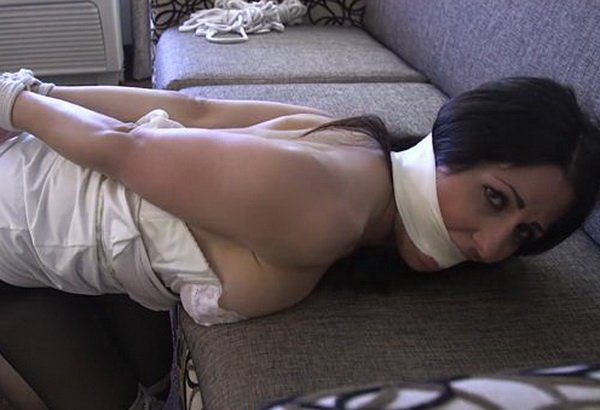 man tied up on couch