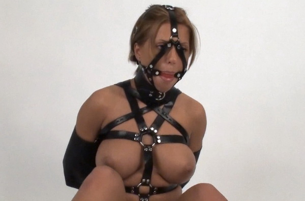 cory spice in tight leather harness bondage posture